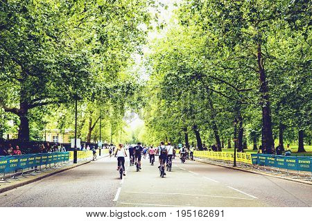 LONDON UNITED KINGDOM - July 30th 2016: People riding their bikes at the Prudential Race in London city centre street