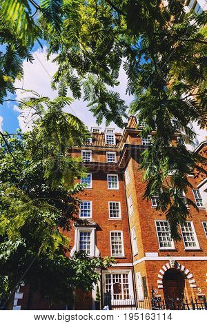 LONDON UNITED KINGDOM - August 6th 2016: Detail of beautiful buildings architecture in the streets of London city centre near Grosvenor Square and Duke Street
