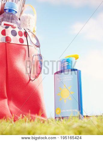 Suntan Lotion and Bag With Beach Items
