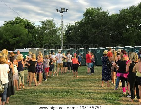 SOUTHAMPTON UK - July 8 2017: Lets Rock Southampton 80s music festival in Southampton UK. People standing in a line waiting to use the portable toilets.