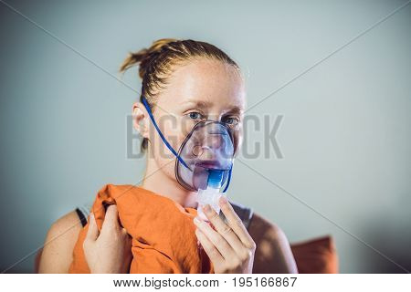 Woman With Flu Or Cold Symptoms Making Inhalation With Nebulizer - Medical Inhalation Therapy