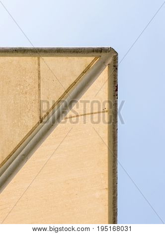 Old canvas canopy with the metal white frame of the modern parking under the clear blue sky.