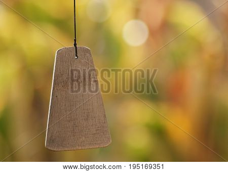 Close up of the bottom of a wooden wind chime