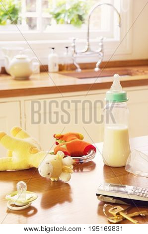 Closeup of baby Items on kitchen counter by cellphone and keys
