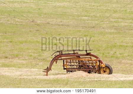 Vintage farm implement in field with copy space