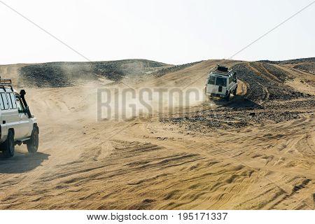 Cars Racing In Desert