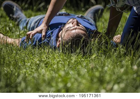 girl assists an unconscious guy after accident
