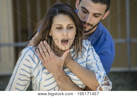 guy making the heimlich maneuver to a girl while she's choking