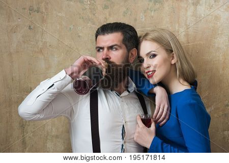 Man Drinking Wine From Bottle And Girl Smiling With Glass