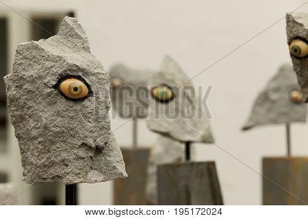Native, Aboriginal artwork of Ecuador with Creepy Eyes on Grey Rocks