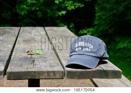Cap resting on a picnic table in a campground