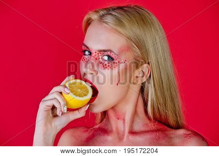 Woman With Creative Fashionable Makeup Bite Lemon, Vitamin