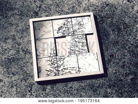 Slide-puzzle with jumbled map (b&w)