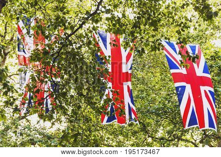 LONDON UNITED KINGDOM - August 12th 2016: Union Jack flag waving above Bruton Street in the affluent area of Mayfair in London city centre
