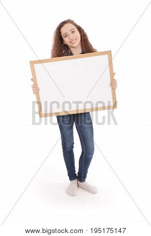 Young girl with picture frame isolated on white