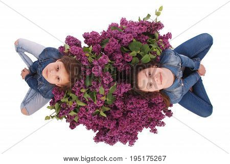 Two beautiful young girl with Blooming flowers on her head. Isolated on white background.
