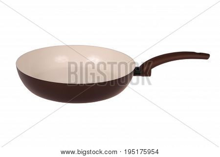 Photo of brown ceramic frying pan isolated on white background with soft shadow. Clipping path