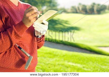 Golfer Writing in Scorecard