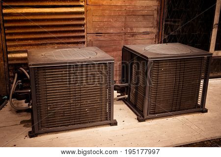 Asia Air Conditioner Compressor Installed On Wooden Background With Copy Space For Text. Air Compres