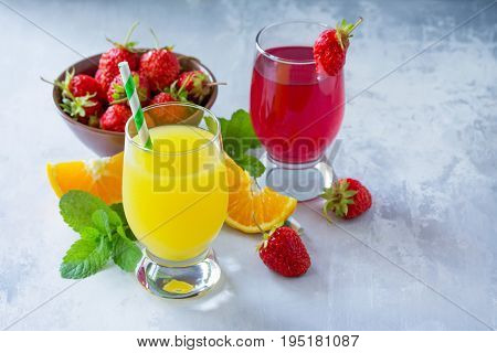 Refreshing Summer Drinks Assortment. Orange Juice, Strawberry Juice, Fresh Oranges And Strawberries