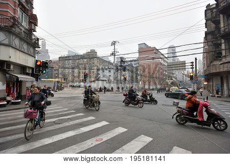 SHANGHAI CHINA - MARCH 18: Unidentified people in a street on March 18 2016 in Shanghai China. Shanghai is the largest Chinese city by population.