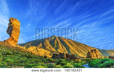 Roques de Garcia stone and Teide mountain volcano in the Teide National Park Tenerife Canary Islands Spain.