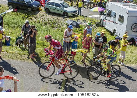 Col du Grand ColombierFrance - July 17 2016: The cyclists Rafal Majka of Thinkoff Team and Ilnur Zakarin of Katusha Team riding on the road to Col du Grand Colombier in Jura Mountains during the stage 15 of Tour de France 2016.