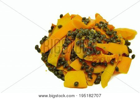 Waste of fruit, peels and seeds after cutting a ripe papaya, a kind of biodegradable organic. Isolated on white background.