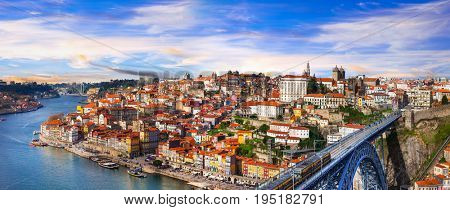 panorama of beautiful Porto over sunset - view with famous bridge. Landmarks of Portugal