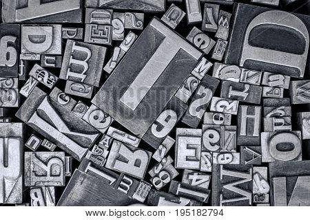 background of vintage letterpress metal type printing blocks, black and white image