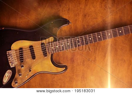 A black custom electric guitar on a leather background