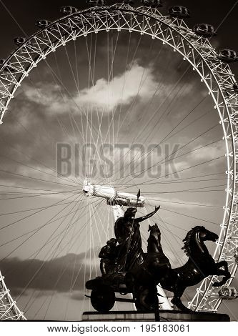 London UK - February 23 2016: The statue of Boadicea underneath Big Ben in Westminster London UKwith the London Eye behind