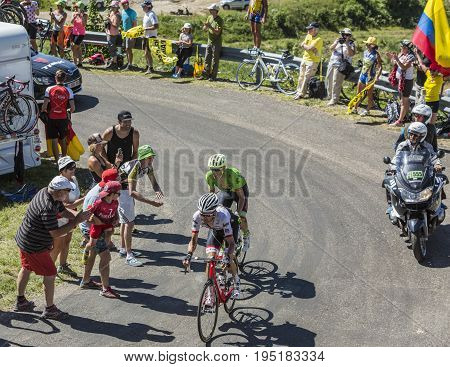Col du Grand ColombierFrance - July 17 2016: The cyclists Haimar Zubeldia of Trek-Segafredo Team and Pierre Rolland of Cannondale-Drapac Team riding on the road to Col du Grand Colombier in Jura Mountains during the stage 15 of Tour de France 2016.