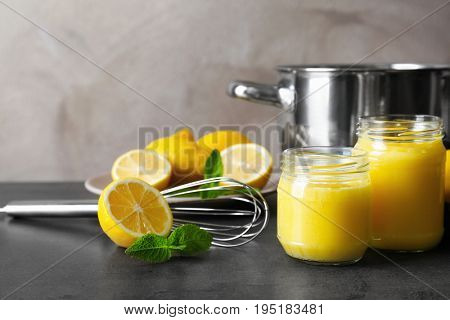 Composition with delicious lemon curd on table