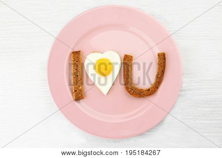 Romantic breakfast with sunny side up egg on table