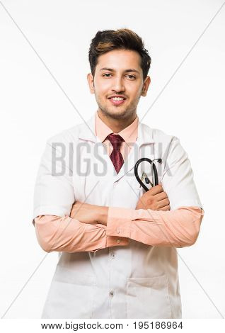 Portrait of an cheerful Indian handsome male doctor with a stethoscope around his neck, isolated over white background, selective focus