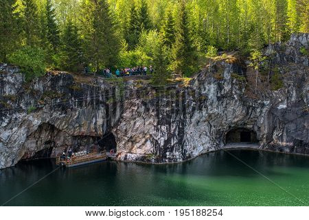 Ruskeala, Sortavala, Republic of Karelia, Russia - June 12, 2017: Marble quarry in Ruskeala Park. Ruskeala - tourist center, located on the ground filled with groundwater former marble quarry.
