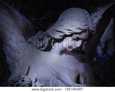 angel of death as a symbol of the end of life (ancient statue)