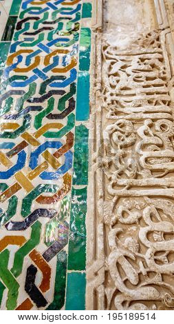 Detailed closeup view of tiles with geometric shapes in various colors, Alhambra, Andalusia, Spain