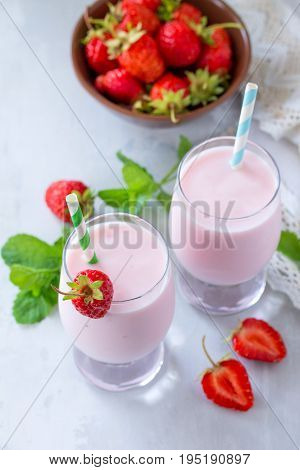 Freshly Squeezed Strawberry Berry Cocktail In A Glass Jar On A Gray Stone Or Slate Background. Super
