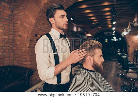 Side View Of Attractive Classy Dressed Barber Shop Stylist, Which Is Presenting The Result Of His St