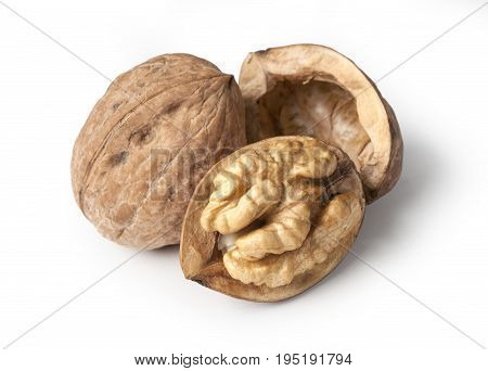 walnut and a cracked walnut isolated on the white background with clipping path