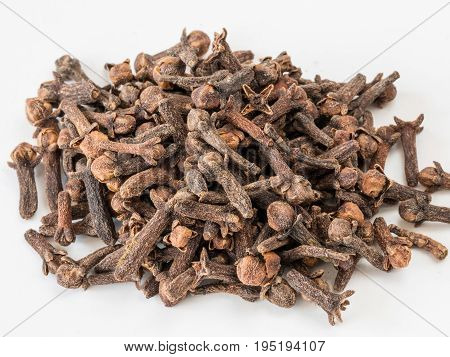 Drying clove spice (Syzygium aromaticum) Cloves are the aromatic flower buds of a tree in the family Myrtaceae.