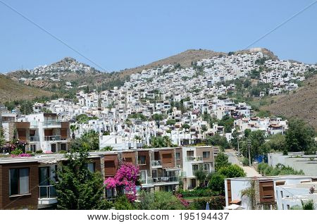 Bagla holiday resort in Turkey near Bodrum. General landscape with hills buildings guesthouses and hotels.