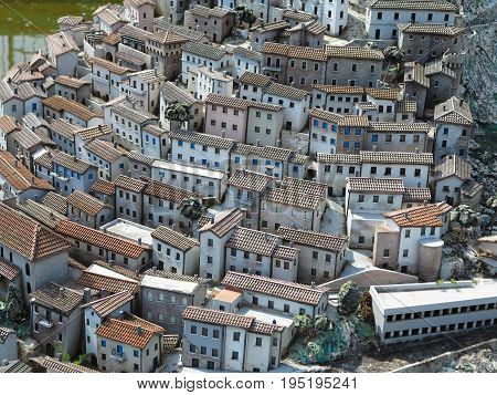 Concept of old medieval city close streets and small houses with tiled roofs