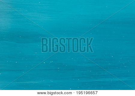 Turquoise painted wood background With drop of paint