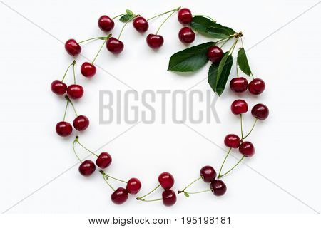 Red Cherry With Petioles Lined In A Frame With Green Leaves. Concept Of Vegetarianism And Love Of Na