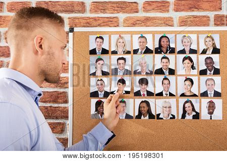 Close-up Of A Businessman Making Selection Of Candidate For Job In Office