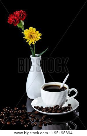 Composition With Cup Of Coffee, Yellow Chrysanthemum And Carnation On A Black Reflective Background