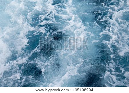 Sea water ship trail with foamy wave. Tropical islands ferry travel. Cruiseliner seawater trail. Deep ocean top view. Big ship pitching image. White swirl wave in sea. Marine cruise travel background